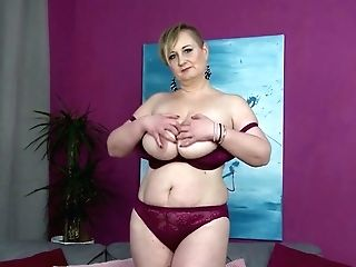 Big Titted Housewife Plays With Her Moist Slit