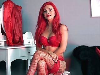 Sexually Charged Crimson Haired Woman Roxi K Tells Erotic Stories In Sexy Undergarments